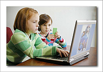 Education of Young Children Image of Two Young Girls at Computer