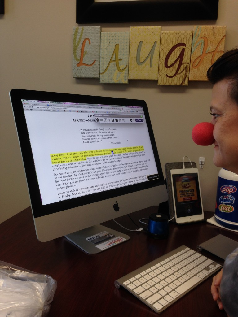 Sandi Mahl (with clown nose) using Read&Write for Google to read a book on Project Gutenberg.