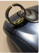 Picture of a child's adjustable ring glued onto a computer mouse